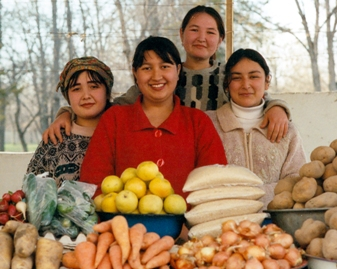 Uzbek women selling produce at local market
