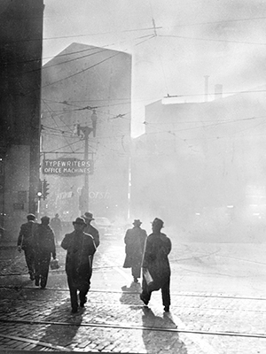 Archival photo of smokey downtown Pittsburgh street